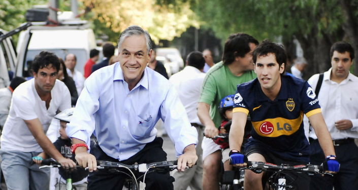 Sebastián Piñera, presidente de Chile, junto a su hijo Cristóbal