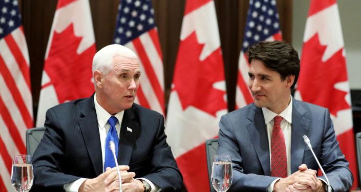 El vicepresidente de EEUU, Mike Pence, y el primer ministro de Canadá, Justin Trudeau