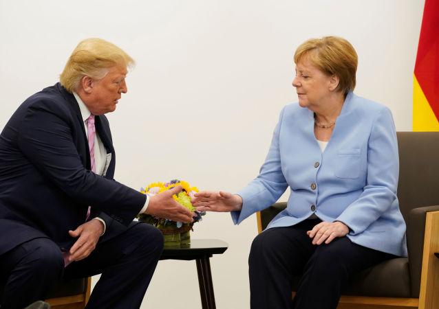 El presidente estadounidense, Donald Trump, y la canciller alemana, Angela Merkel