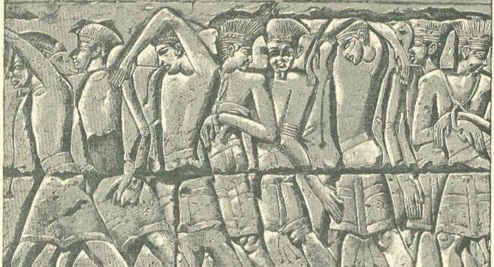 Procesión de filisteos capturados, bajorrelieve del templo de Medinet Habu