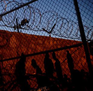 Los migrantes en la frontera entre EEUU y México