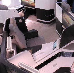 Una maqueta de la sección de clase business a bordo del CR929
