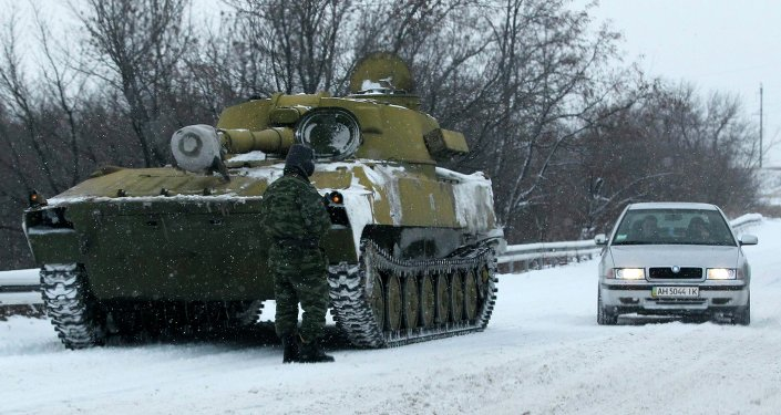 An unmarked 122-mm self-propelled howitzer is seen on the road from Luhansk to Donetsk