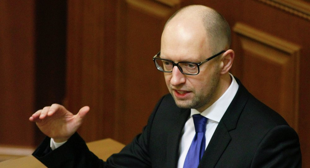 Ukraine's Prime Minister Arseny Yatseniuk speaks to deputies as he presents a work plan of his government during a parliament session in Kiev, December 11, 2014