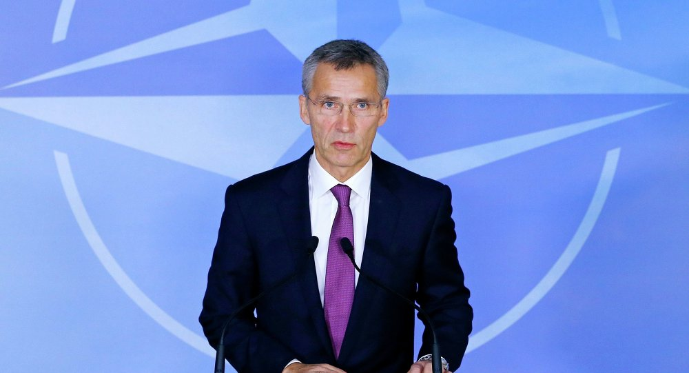 NATO Secretary General Jens Stoltenberg speaks at the Alliance's headquarters ahead of NATO foreign ministers meeting in Brussels, December 2, 2014