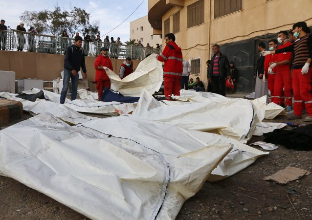 Medics cover the bodies of victims at a hospital after air strikes in Raqqa, eastern Syria, which is controlled by the Islamic State November 25, 2014