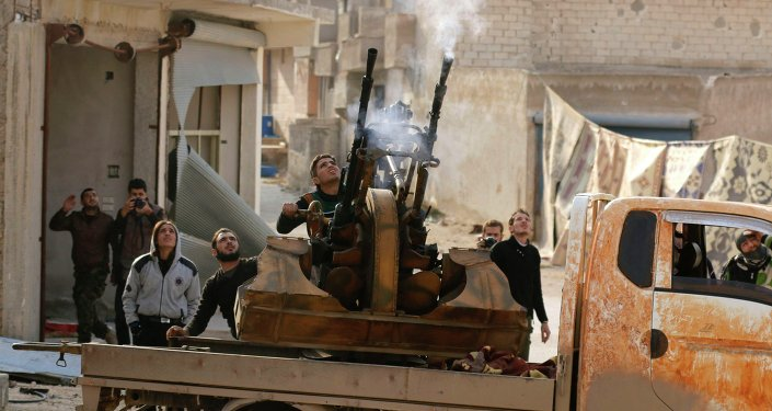 Free Syrian Army fighters fire an anti-aircraft weapon towards forces loyal to Syria's President Bashar al-Assad in the Handarat area, north of Aleppo November 30, 2014