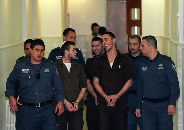 Israeli prison guards escort far-right activists Yitzhak Gabai, Nahman Twito and Shlomo Twito at Jerusalem District Court December 15, 2014