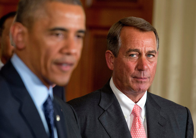 House Speaker John Boehner, R-Ohio, right, watches President Barack Obama speak
