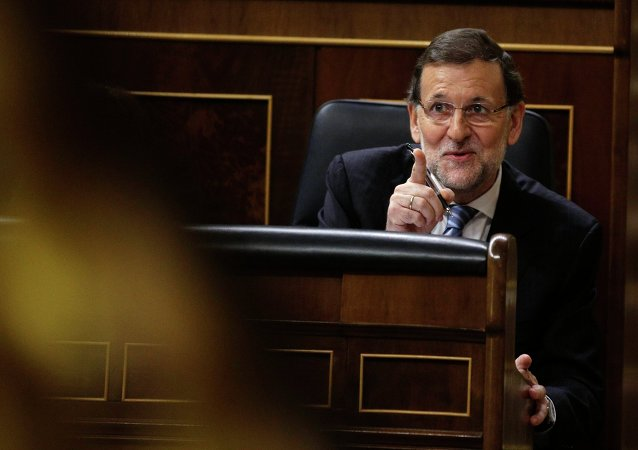 Spain's Prime Minister Mariano Rajoy reacts after presenting anti-corruption measures at Spanish parliament in Madrid, November 27, 2014.