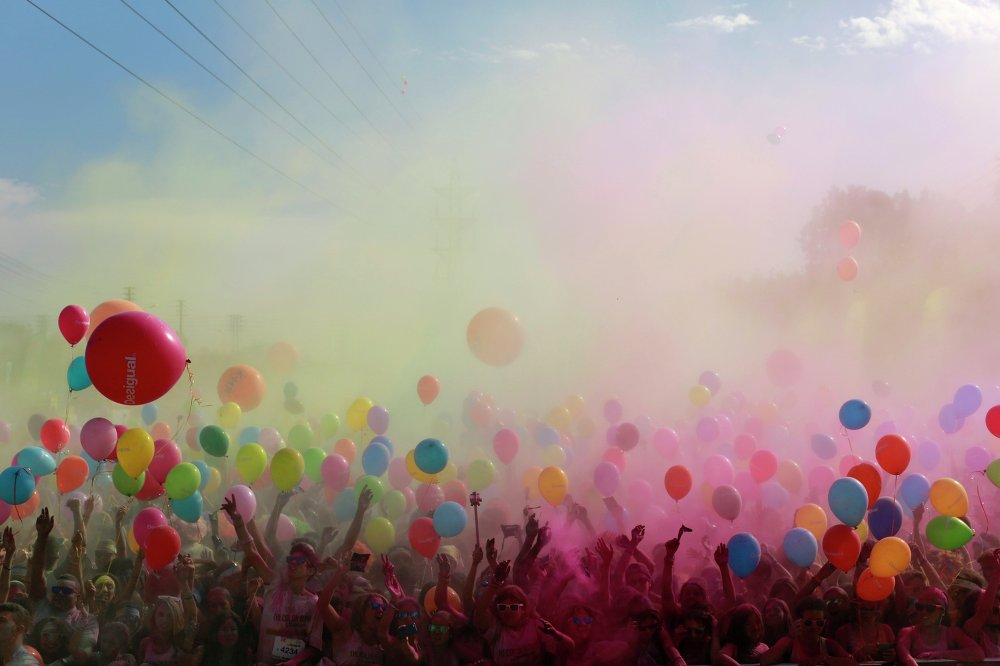 Participants throw coloured powders as they take part in the Color Run in the Andalusian capital of Seville November 2, 2014.