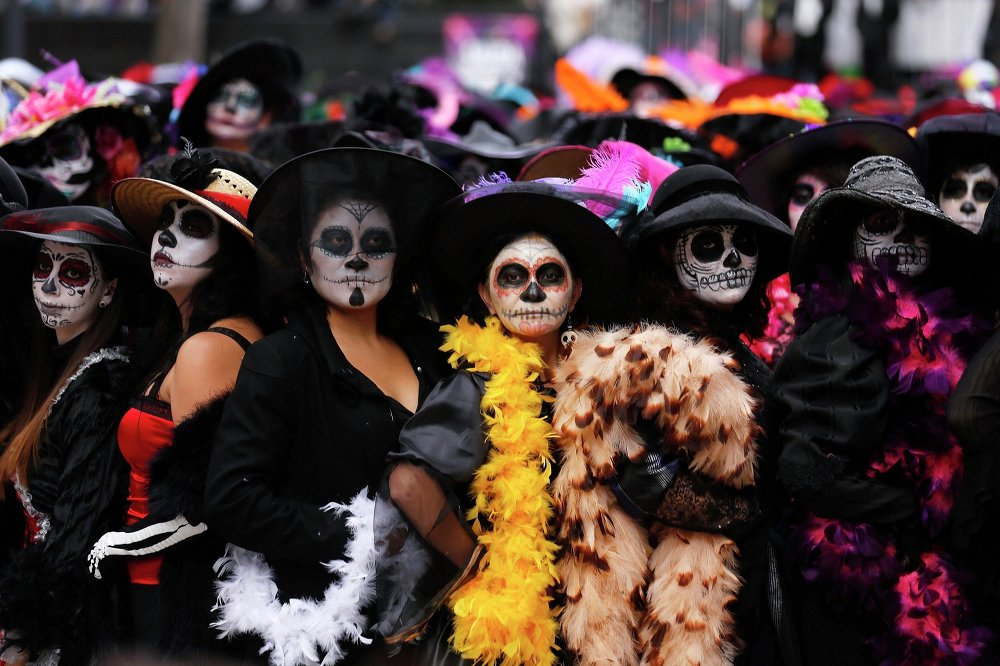 Women, with faces painted to look like the popular Mexican figure called Catrina, take part in a world record attempt in downtown Mexico City November 1, 2014.