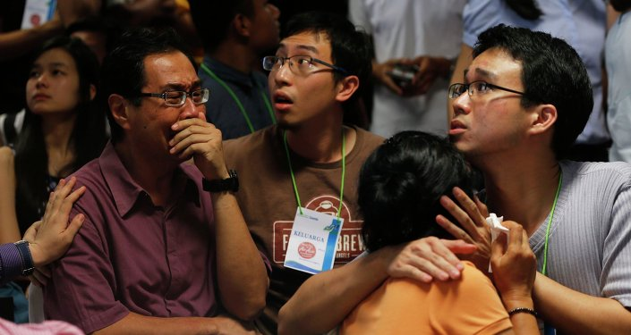Family members of passengers onboard missing AirAsia flight QZ8501 cry at a waiting area in Juanda International Airport, Surabaya December 30, 2014