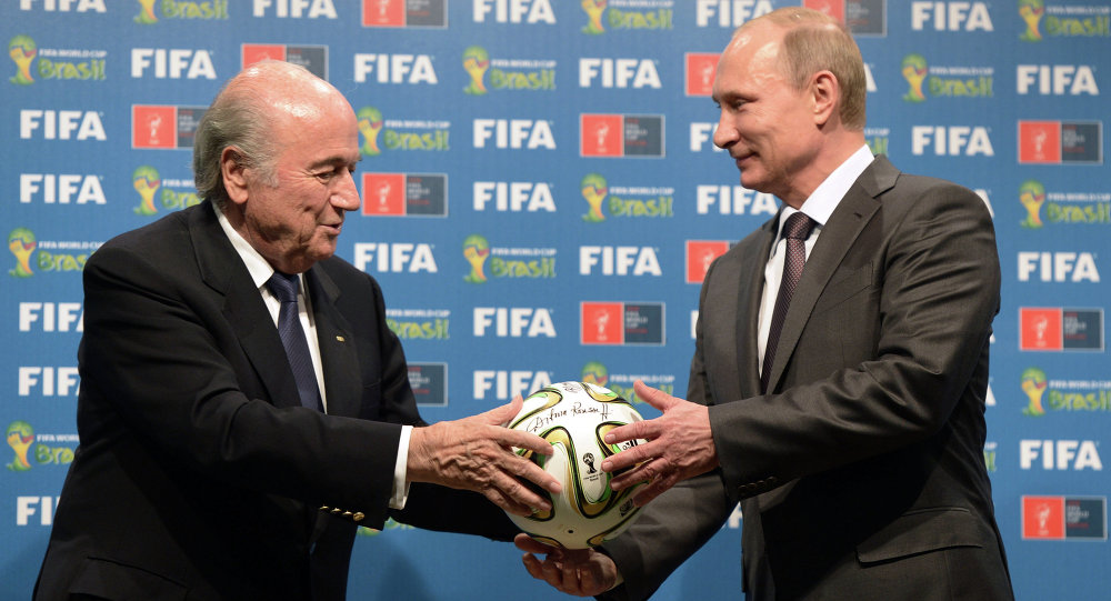 Russia's President Vladimir Putin (R) and FIFA President Joseph Blatter