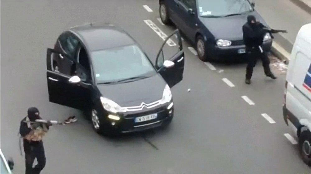Gunmen flee the offices of French satirical newspaper Charlie Hebdo in Paris, in this still image taken from amateur video shot on January 7, 2015, and obtained by Reuters