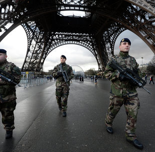 French soldiers patrol in front of the Eiffel Tower