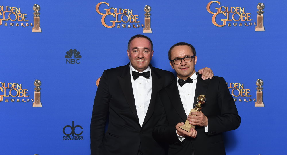 Alexander Rodnyansky and Andrey Zvyagintsev pose with the award for Best Foreign Language Film for Leviathan, in the press room at the 72nd annual Golden Globe Awards