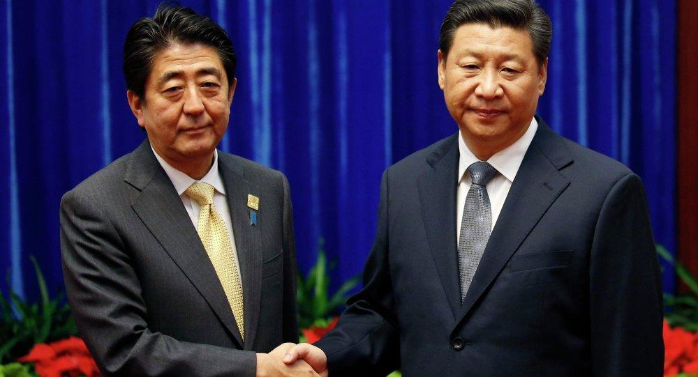 Shinzo Abe, primer ministro de Japón y Xi Jinping, presidente de China