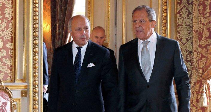Serguéi Lavrov y  Laurent Fabius