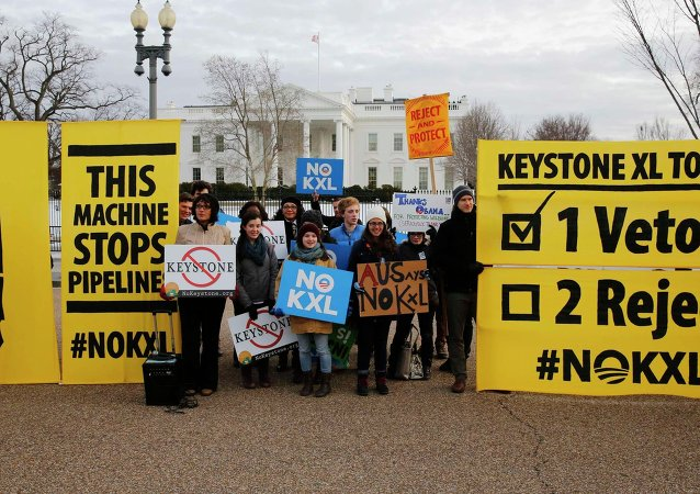 Veto supporters rally in front of the White House on the same day U.S. President Barack Obama vetoed a Republican bill approving the Keystone XL oil pipeline from Canada