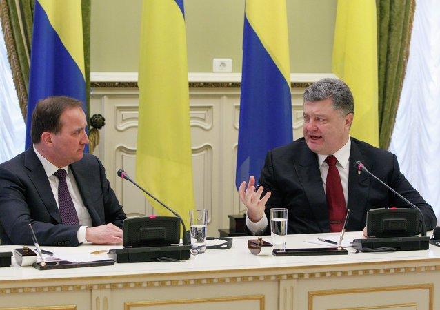Stefan Löftven, primer ministro de Suecia, y Petró Poroshenko, presidente de Ucrania