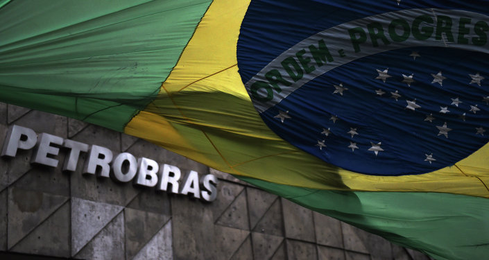 The Brazilian national flag flutters at the front of the headquarters of the Brazilian state oil giant Petrobras, in Rio de Janeiro, Brazil, on March 13, 2015