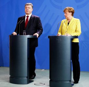 Presidente de Ucrania, Petro Poroshenko y Canciller de Alemania, Angela Merkel