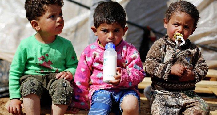 Niños sirios en un campamento de refugiados cerca de Ammán, capital de Jordania (marzo de 2015)
