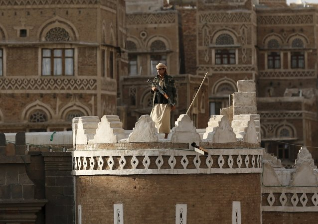 A Houthi fighter stands guard