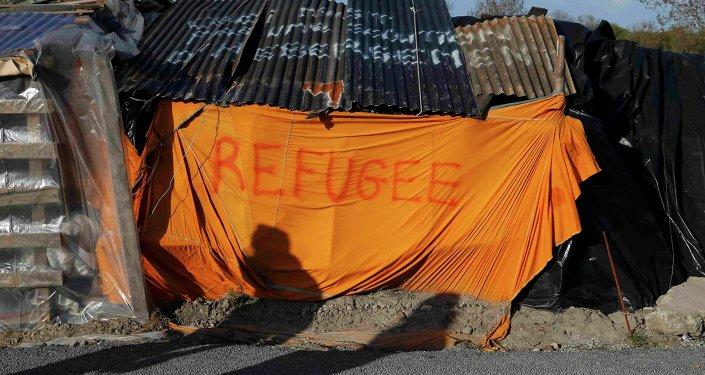 Campo de refugiados africanos en Francia