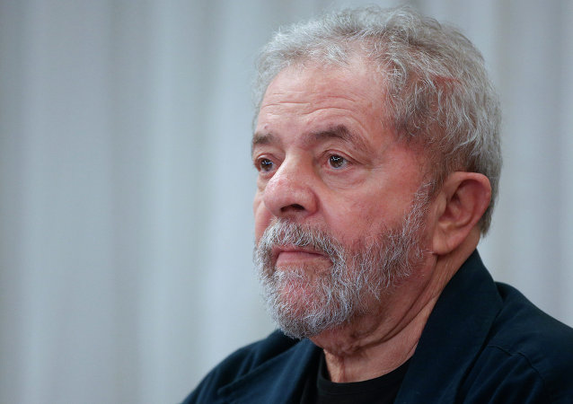 Brazil's former President Luiz Inacio Lula da Silva attends an extraordinary Worker's Party leaders meeting in Sao Paulo, Brazil, Monday, March 30, 2015