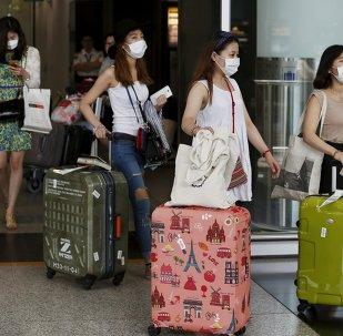Turistas de Corea del Sur en el aeropuerto de Hong Kong