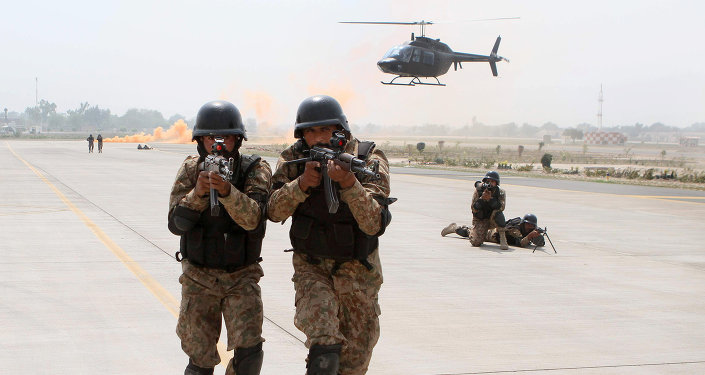 Pakistani soldiers take part in a drill against terrorists at the Multan International Airport in Multan on March 19, 2015