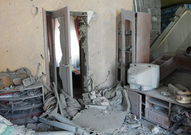 Casa afectada por los bombardeos de Donetsk