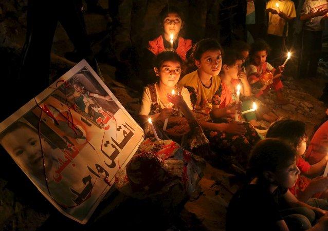 Reunión para conmemorar el bebe Ali Dawabsha, Franja de Gaza, el 2 de agosto, 2015