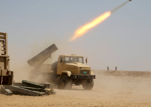 Iraqi security forces launch a rocket towards Islamic State militants on the outskirts of Anbar province, Iraq August 22, 2015