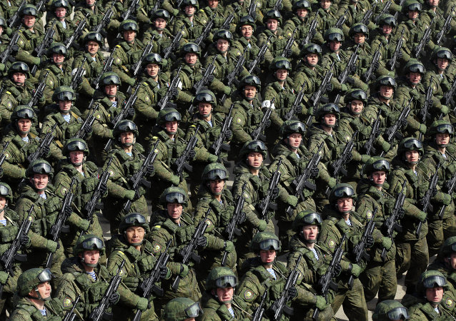 Russian soldiers march during a rehearsal of the Victory Day Parade in Alabino, outside Moscow, on April 22, 2015