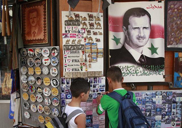 Póster con el rostro de Bashar Asad