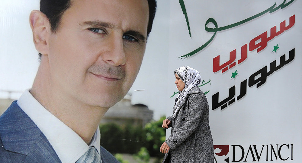 Una imagen del presidente sirio, Bashar Asad, en Damasco