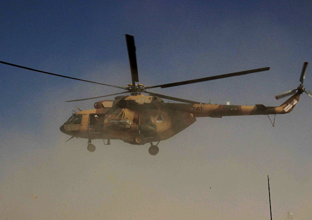 An Afghan helicopter carrying security personnel arrives at the scene of an offensive against Taliban insurgents in Kunduz on September 30, 2015