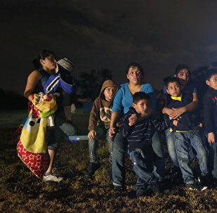 A group of young migrants from Honduras and El Salvador who crossed the U.S.-Mexico border illegally as they are stopped in Granjeno, Texas