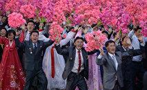 Norcoreanos participan en una fiesta nacional (Archivo)