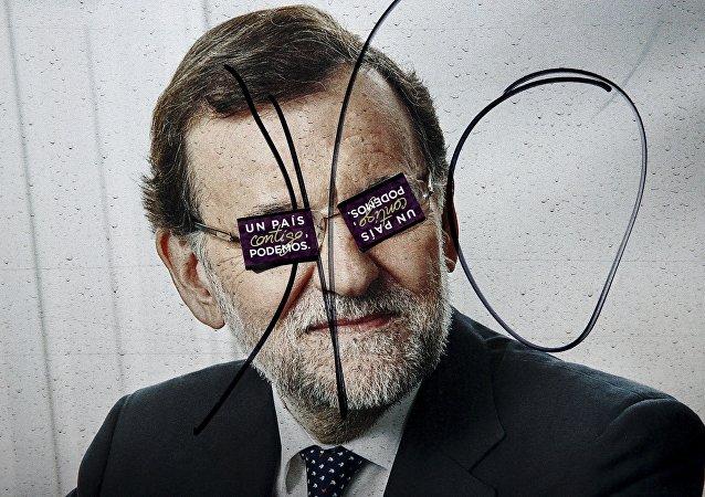 Un cartel electoral con la imagen de Mariano Rajoy en Madrid