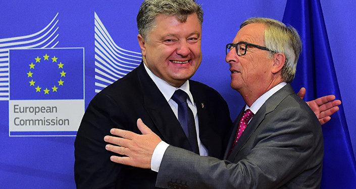 Presidente de Ucrania, Petró Poroshenko y  presidente de la Comisión Europea, Jean-Claude Juncker