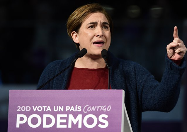 Barcelona's Mayor Ada Colau speaks during a campaign meeting of left wing party Podemos in Madrid on December 13, 2015.