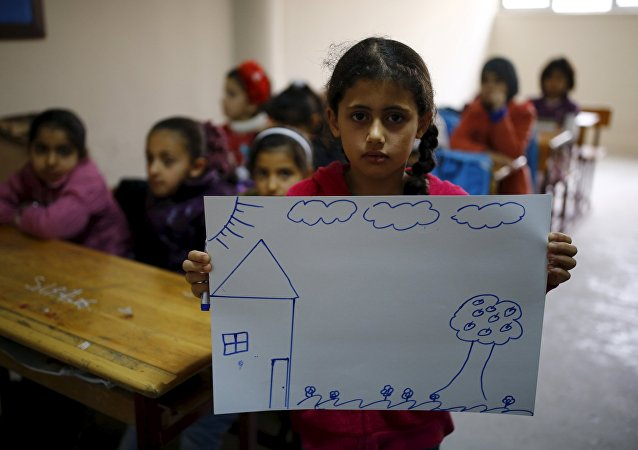 The Wider Image: Young Syrians dream of home