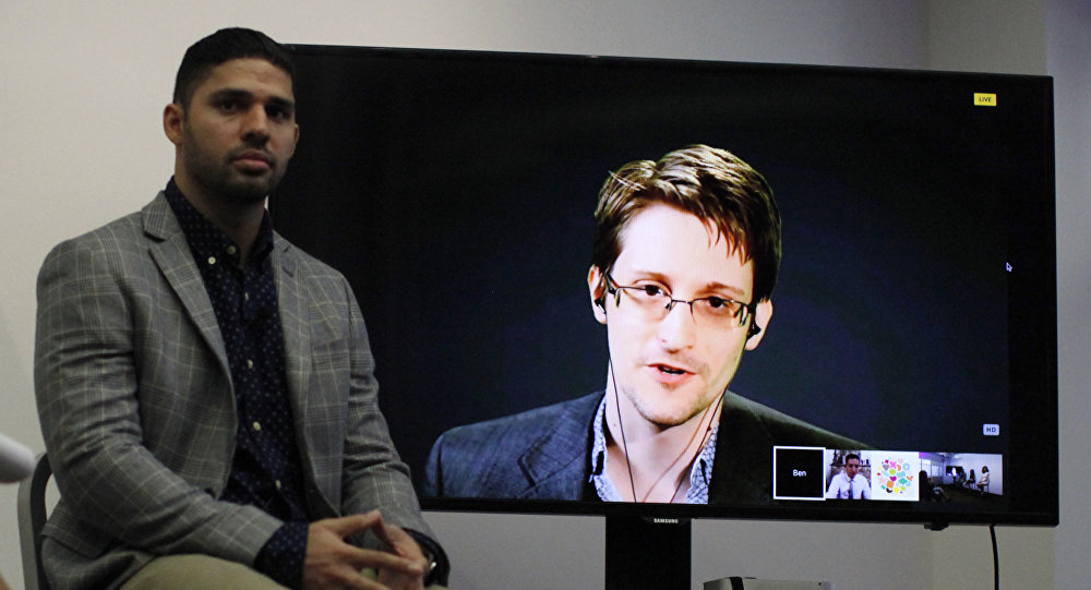 Periodista David Miranda y Edward Snowden