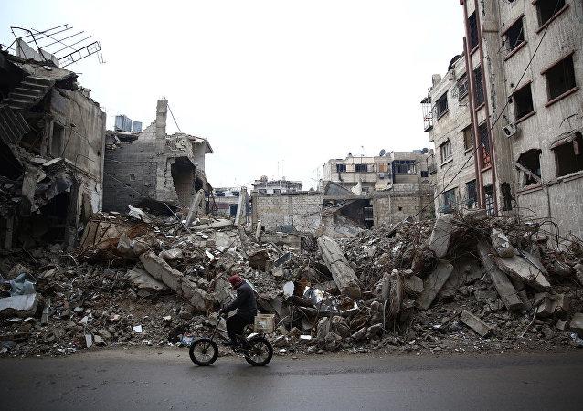 Edificios destruidos en las afueras de Damasco, la capital de Siria