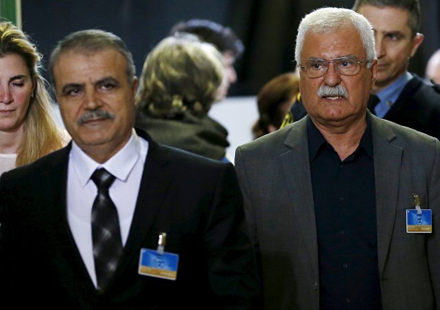Asaad Al-Zoubi, head of the Syrian opposition delegation, arrives with George Sabra, a member of the High Negotiations Committee (HNC),