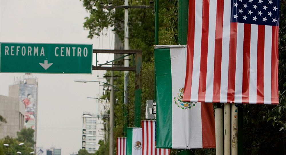 Mexican and US flags are seeing in an avenue close to the Los Pinos residence on April 15, 2009 in Mexico city, prior the US President Barack Obama 24-hour visit to Mexico starting on April 16th.